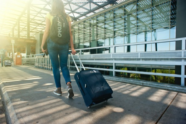 Girl carrying suitcase